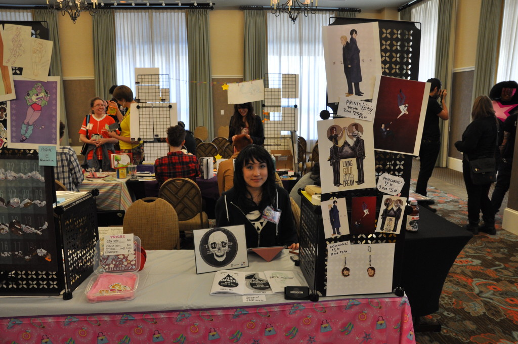 Me at my booth in my Triana Orpheus cosplay.